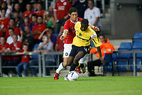Photo: Marc Atkins.<br />Oxford United v Manchester United XI. Pre Season Friendly. 08/08/2006. Eddie Anaclet of Oxford (R) tangles with Christiano Ronaldo.