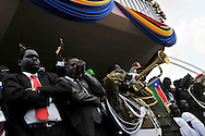 Government officials are moved as the new flag of the Republic of South Sudan is raised at the official independence day ceremony. After decades of conflict, Southern Sudan declared independence from the North on July 9th, 2011. Government officials, foreign dignitaries and ordinary people came to the John Garang Memorial in the capital from all over the country and the world to celebrate the historic occation..Juba, South Sudan. 09/07/2011..Photo © J.B. Russell