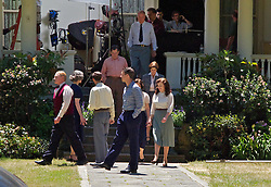 Actors walk outside one of the historic officer's mansions along Walnut Ave on Mare Island as oscar-winning director Paul Thomas Anderson's  film  'The Master' begins filming.  The post WWII- era movie will star Philip Seymour Hoffman, Joaquin Phoenix, Amy Adams and Laura Dern.