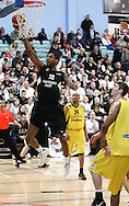 Guildford, England, Sunday 21st March 2010:  Andrew Sullivan of Newcastle leaps high to score during the  BBL Trophy Final between Cheshire Jets and Newcastle Eagles at the Guildford Spectrum, Surrey, UK. Final score Cheshire 95-111 Newcastle.  (photo by Andrew Tobin/SLIK images)