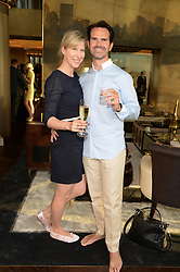 An exclusive preview of the new Samsung OLED Curved TV has hosted by Nick & Holly Candy at their home at One Hyde Park, London on 29th August 2013.<br /> Picture shows:-Jimmy Carr and Karoline Copping.