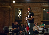 Comic Paul Landwehr takes the stage during the Belknap Mill's Evening of Comedy event hosted by Fusion on Saturday evening.   (Karen Bobotas/for the Laconia Daily Sun)