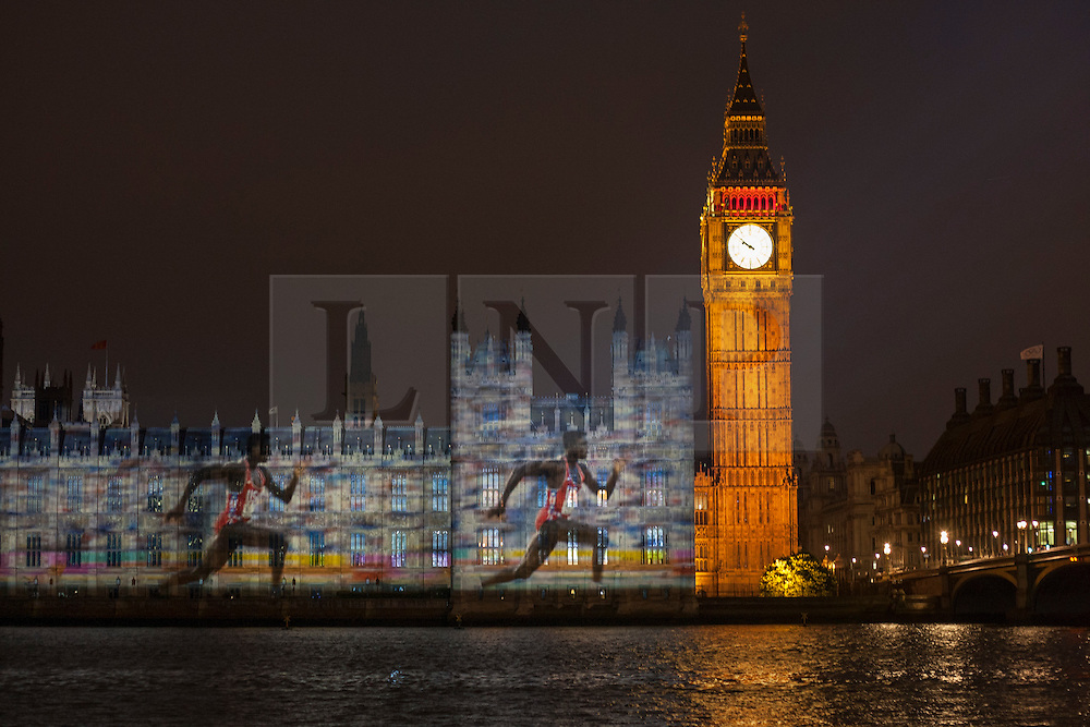 © licensed to London News Pictures. London, UK 27/07/2012. Picture of Carl Lewis being projected on the Houses of the Parliaments during the Olympics opening ceremony on 27/07/12. Photo credit: Tolga Akmen/LNP