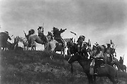 Native American Indians on horseback on hill, c1907.  Photograph by Edward Curtis (1868-1952).
