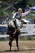 061811-Evergreen, COLORADO-evergreenrodeo-Bareback rider Craig Wisehart, of Stephenville, TX, hangs on during the Evergreen Rodeo Saturday, June 18, 2011 at the El Pinal Rodeo Grounds..Photo By Matthew Jonas/Evergreen Newspapers/Photo Editor