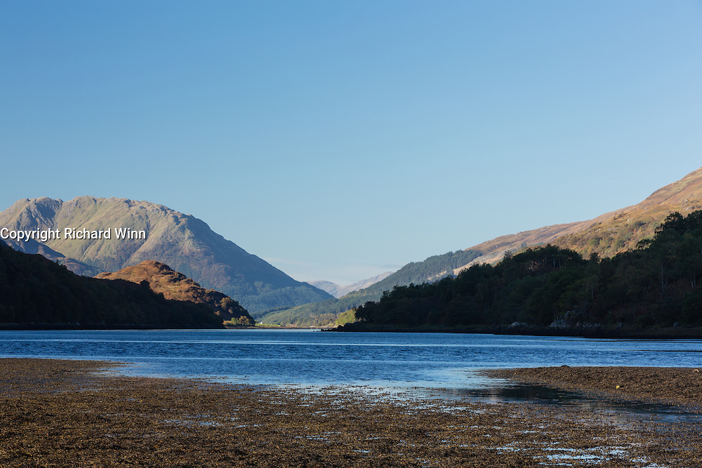 The rocky shoreline of Loch Leven, at its head, just outside Kinlochleven as the tide starts flowing.