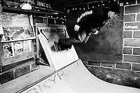 John warms up on the mini-ramp before a long night of skateboarding at the Danger Room.........................