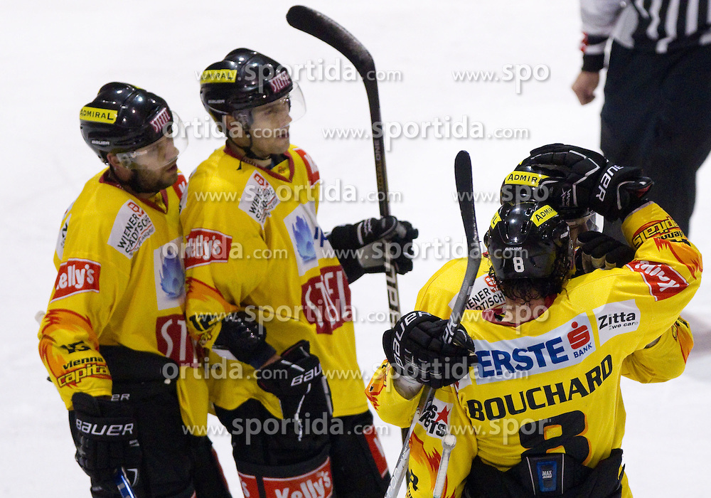 David Rodman (2L) celebrates with players of Vienna during  ice-hockey match between HK Acroni Jesenice and EV Vienna Capitals of 44th Round of EBEL league, on January 30, 2011 in Arena Podmezkla, Jesenice, Slovenia. Acroni Jesenice defeated Vienna 4-3. (Photo By Vid Ponikvar / Sportida.com)