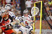 DENVER, CO - JULY 4: Goalie Jordan Burke #5 of the Boston Cannons defends his own goal while playing against the Denver Outlaws during their MLL game at Sports Authority Field at Mile High on July 4, 2015 in Denver, Colorado. (Photo by Marc Piscotty/Getty Images) *** Local Caption *** Jordan Burke