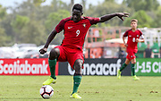 Portugal forward Herculano Nabian (9) dribbles to avoid a tackle in a game against Slovenia during a CONCACAF boys under-15 championship soccer game, Sunday, August 11, 2019, in Bradenton, Fla. Portugal defeated Slovenia in the final in 2-0. (Kim Hukari/Image of Sport)