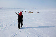 Canadian Inuit Rangers poses with his museum-worthy WW2 Lee Enfield .303 rifle near his camp on Cornwallis Island, Nunavut during Nunalivut 2012 sovereignty exercise by Canadian Forces in arctic Canada. April 2012.