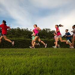 Runners of all ages run the mile in the first event during a all comers track event sponsored by the New Orleans Club held at St Martin's Episcopal  in Metairie, La. Friday, July 7, 2017.