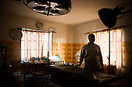 A licensed doctor and known abortion provider stands in the operating of his private clinic, located blocks from one of the biggest public hospitals in the city, in Lagos, Nigeria, August 22, 2013.  He asked that his identity not be disclosed.