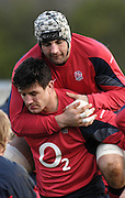 Bath, GREAT BRITAIN, Danny GREWCOCK climbs on the back of Martin CORRY, during the the England Rugby training session at Bath University Sports Complex, ENGLAND  [Photo, Peter Spurrier/Intersport-images].....