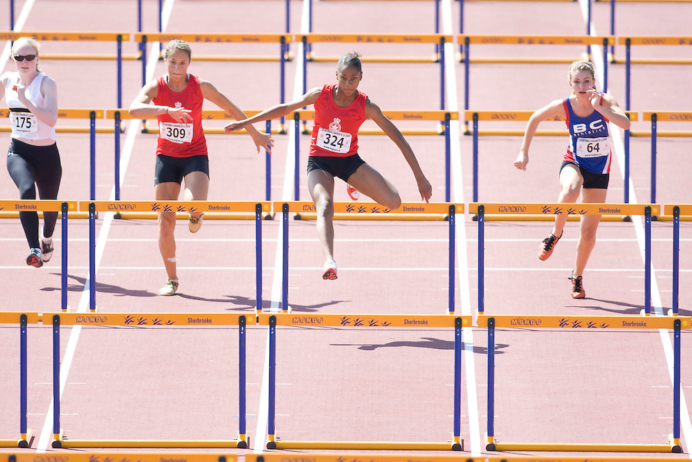 (Sherbrooke, Quebec---9 August 2008) from left to right, Taylor Farquhar (309), Chanice Taylor-Chase (324), and Jade Vaughan (64) competing in the girls 15 and under 80m hurdles final at the 2008 Canadian National Youth and Royal Canadian Legion Track and Field Championships in Sherbrooke, Quebec. The photograph is copyright Sean Burges/Mundo Sport Images, 2008. More information can be found at www.msievents.com.