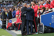 Manchester United Manager Jose Mourinho greets Brighton and Hove Albion manager Chris Hughton during the Premier League match between Brighton and Hove Albion and Manchester United at the American Express Community Stadium, Brighton and Hove, England on 19 August 2018.