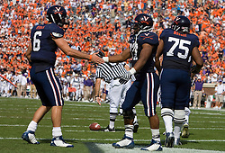Virginia quarterback Marc Verica (6) congratulates Virginia running back Cedric Peerman (37) after Peerman's second touchdown of the game.  The Virginia Cavaliers defeated the East Carolina Pirates 35-20 in NCAA football at Scott Stadium on the Grounds of the University of Virginia in Charlottesville, VA on October 11, 2008.
