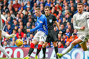 Ryan Kent of Rangers FC goes through a 50/50 challenge right in front of the Referee during the Ladbrokes Scottish Premiership match between Rangers and Aberdeen at Ibrox, Glasgow, Scotland on 27 April 2019.