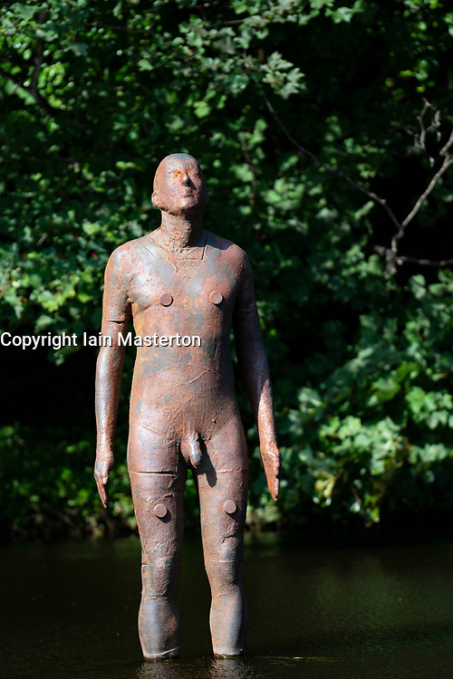 "Antony Gormley ""6 Times"" ""Sky"" sculpture in the Water of Leith in Edinburgh, Scotland, UK. comprising six life-size figures, positioned between the  the Scottish National Gallery of Modern Art and Leith Docks. - Editorial Use Only _"