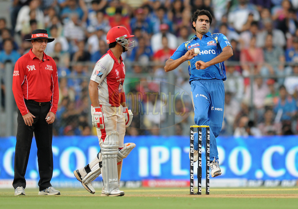 Munaf Patel of Mumbai Indians bowls during match 28 of the Indian Premier League ( IPL) 2012  between The Mumbai Indians and the Kings X1 Punjab held at the Wankhede Stadium in Mumbai on the 22nd April 2012..Photo by Pal Pillai/IPL/SPORTZPICS.