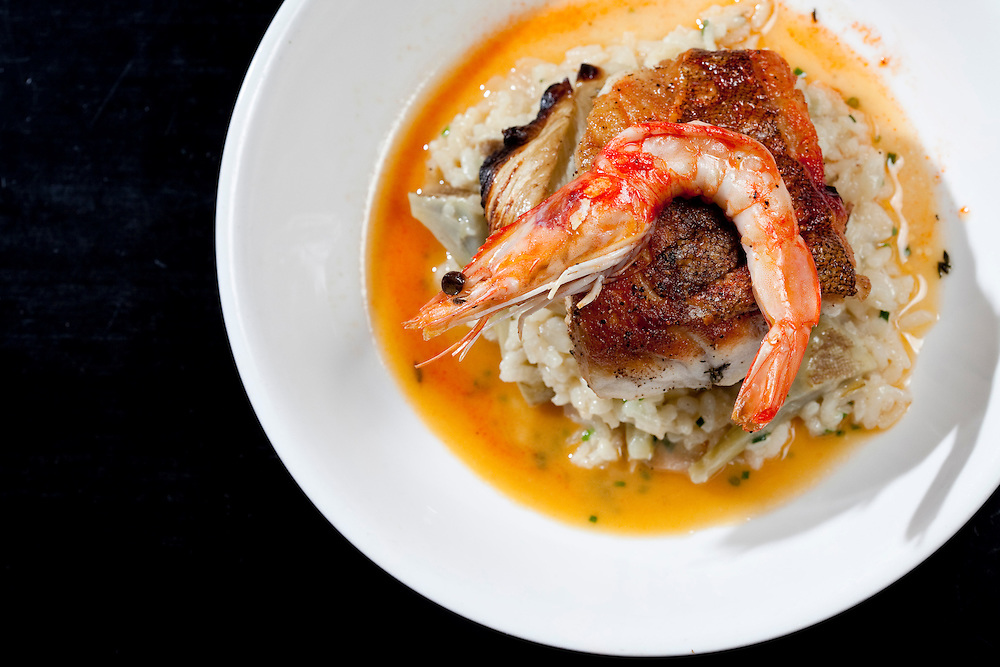 03/01/2012 - Somerville, Mass. - Red grouper on a bed of artichoke risotto, topped with a giant prawn, at Pizzeria Posto in Somerville's Davis Square on March 1, 2012. (Kelvin Ma/Tufts University)