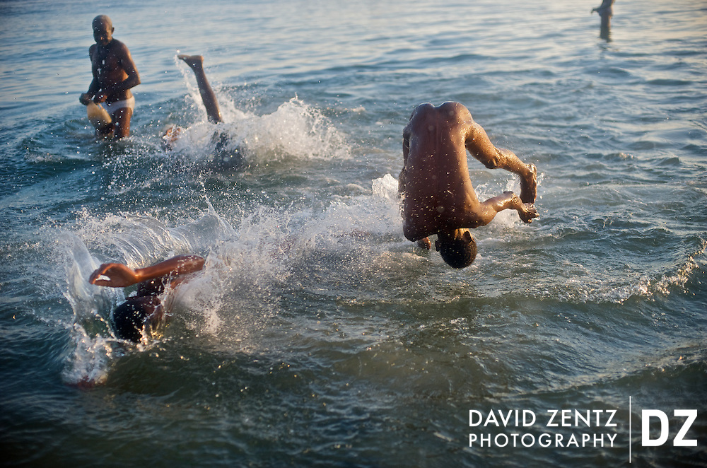 Boys frolick in the ocean during an annual voodou festival at Bord de Mer de Limonade on the north coast of Haiti on July 25, 2008.