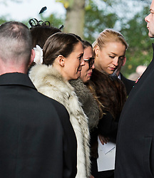 © London News Pictures. 05/11/2014. NATASCHA and KYLA (front) daughters of jack Bruce, emotional as they enter the church. The funeral Jack Bruce at Golders Green Crematorium in North London. Jack Bruce was the lead singer and bass player for British Rock band Creme, alongside Eric Clapton and Ginger Baker. Creme sold over 15 million albums worldwide and were widely considered to be the worlds first successful supergroup. Photo credit : Ben Cawthra/LNP