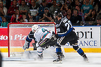 KELOWNA, CANADA - APRIL 17: Gordie Ballhorn #4 of Kelowna Rockets takes a shot on Coleman Vollrath #35 of Victoria Royals during second period on April 17, 2016 at Prospera Place in Kelowna, British Columbia, Canada.  (Photo by Marissa Baecker/Shoot the Breeze)  *** Local Caption *** Gordie Ballhorn; Coleman Vollrath;
