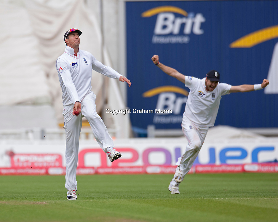 Kevin Pietersen (left) celebrates catching Sreesanth to win the third npower Test Match between England and India at Edgbaston, Birmingham.  Photo: Graham Morris (Tel: +44(0)20 8969 4192 Email: sales@cricketpix.com) 13/08/11