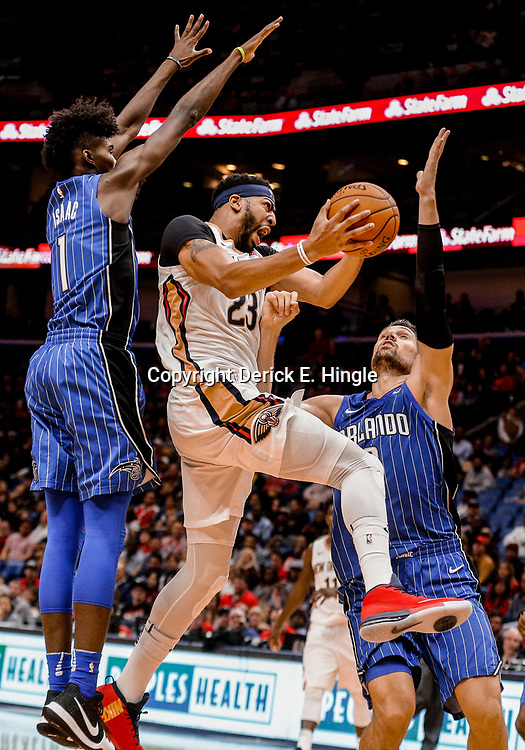 Oct 30, 2017; New Orleans, LA, USA; New Orleans Pelicans forward Anthony Davis (23) shoots over Orlando Magic forward Jonathan Isaac (1) and center Nikola Vucevic (9) during the second half of a game at the Smoothie King Center.The Magic defeated the Pelican 115-99.  Mandatory Credit: Derick E. Hingle-USA TODAY Sports