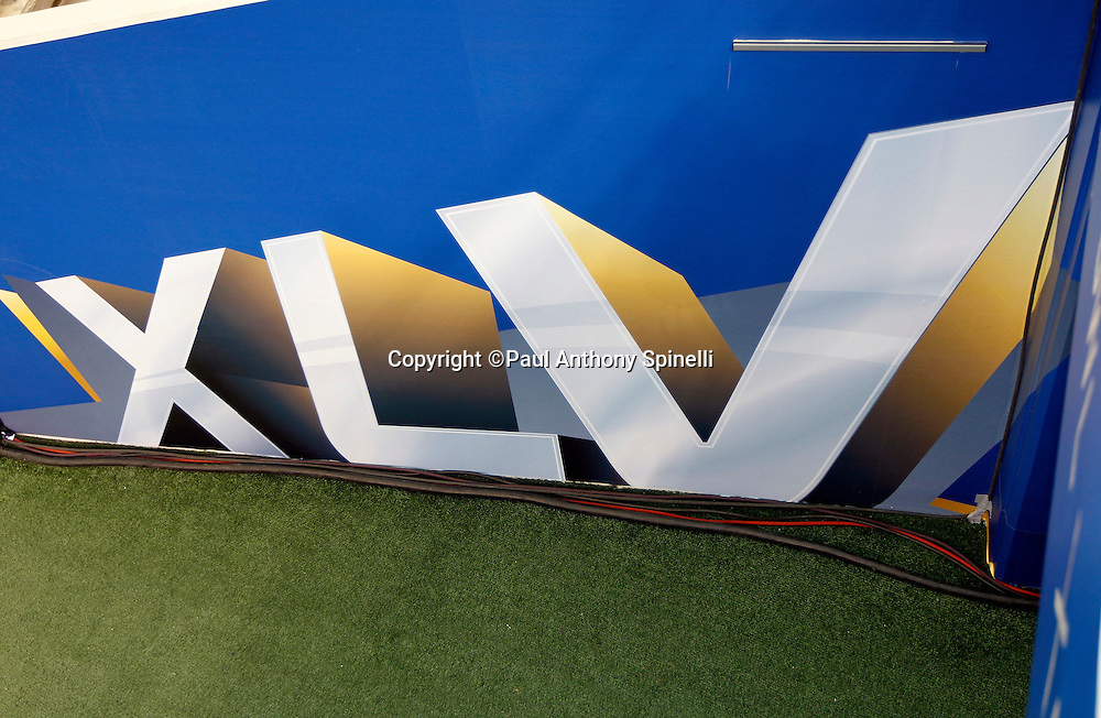 The Super Bowl XLV logo decorates a sideline banner as the AFC Pittsburgh Steelers speak to the press at Super Bowl XLV media day prior to NFL Super Bowl XLV against the Green Bay Packers. Media day was held on Tuesday, February 1, 2011 in Arlington, Texas. ©Paul Anthony Spinelli