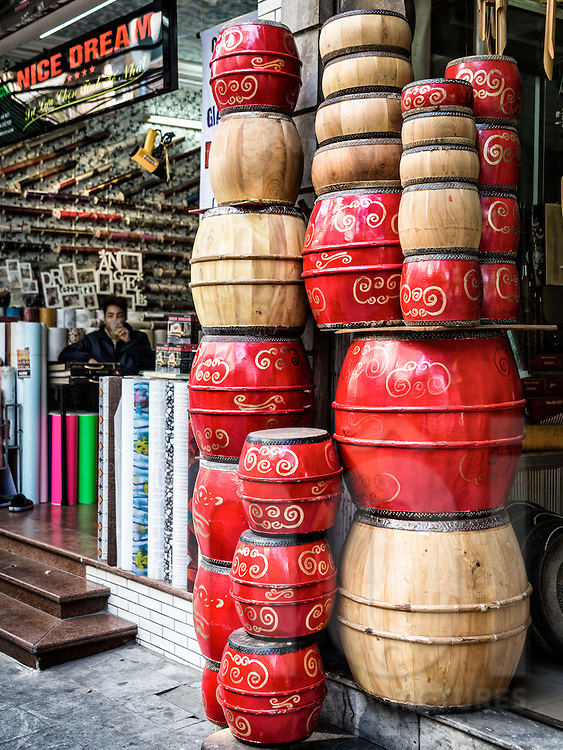 Traditional drums are piled on top of each other outside a musical instrument shop along Hang Manh street in Hanoi's Old Quarter, Vietnam, Southeast Asia