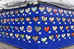 © Licensed to London News Pictures. 21/05/2018. LONDON, UK.  Memorial hearts cover a hoarding around Notting Hill Methodist Church close to the Grenfell Tower in West London on the day that commemoration hearings begin in the Millennium Gloucester hotel.  Over the next nine days, friends and family will be paying tributes to the 72 victims killed by the fire in the tower nearly one year ago.  Photo credit: Stephen Chung/LNP