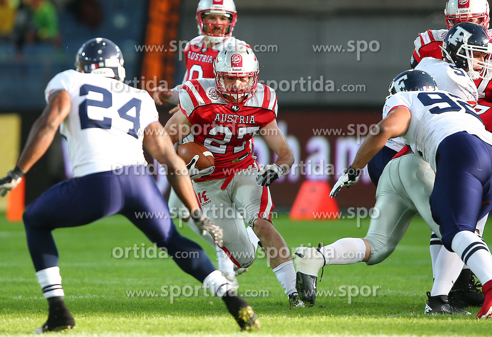 04.06.2014, UPC Arena, Graz, AUT, American Football Europameisterschaft 2014, Gruppe B, Frankreich (FRA) vs Oesterreich (AUT), im Bild Sebastien  Sejean , (Team France, DB , #24), Andreas Hofbauer, (Team Austria, RB, #27) und  XArnaud  Couanon Vertueu , (Team France, LB , #92) // during the American Football European Championship 2014 group B game between France vs Austria at the UPC Arena, Graz, Austria on 2014/06/04. EXPA Pictures © 2014, PhotoCredit: EXPA/ Thomas Haumer