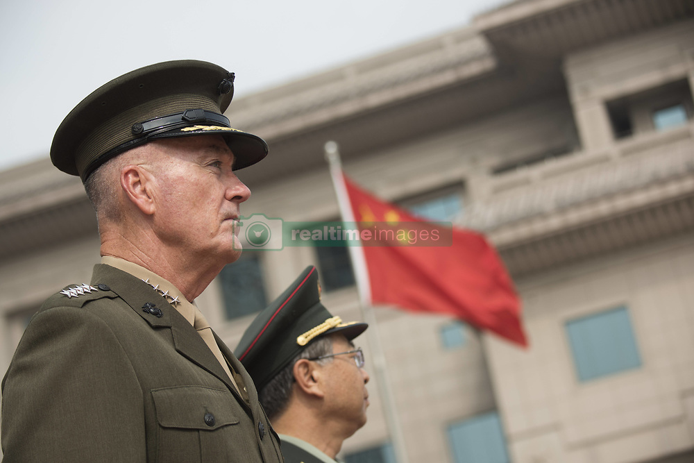 August 15, 2017 - Beijing, China - U.S. Chairman of the Joint Chiefs Gen. Joseph Dunford, left, during a red carpet arrival ceremony with his Chinese counterpart Chinese People's Liberation Army Gen. Fang Fenghui at the Bayi building August 15, 2017 in Beijing, China. Dunford and Fang signed an agreement to strengthen communication between the two militaries amid tensions concerning North Korea. (Credit Image: © Dominique A. Pineiro/Planet Pix via ZUMA Wire)