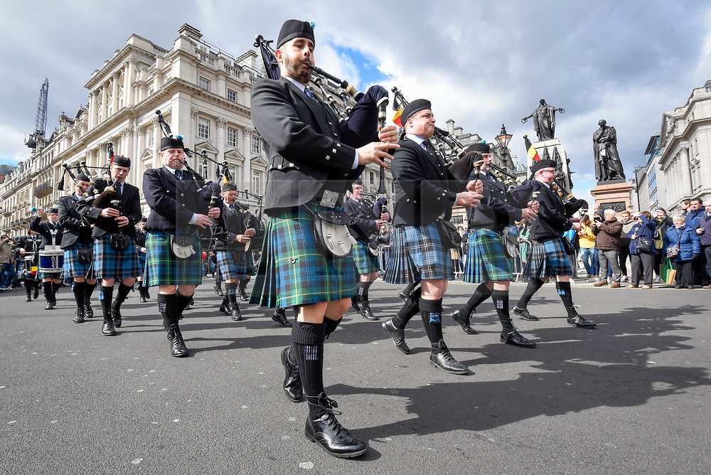 © Licensed to London News Pictures. 17/03/2019. LONDON, UK.  An Irish marching band passes by during the annual St. Patrick's Day parade and festival in the capital.  Photo credit: Stephen Chung/LNP