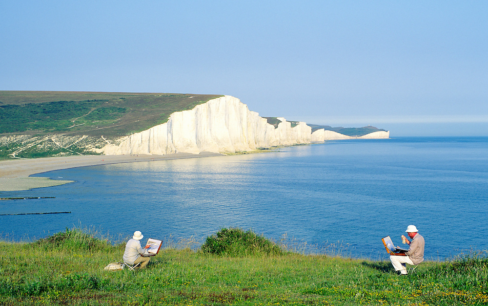 English Channel white chalk cliffs known as the Seven Sisters. East Sussex, England. Watercolour painters artists painting.