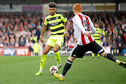 Huddersfield Town midfielder Philip Billing (8) is closed down by Brentford midfielder Ryan Woods (15) during the EFL Sky Bet Championship match between Brentford and Huddersfield Town at Griffin Park, London, England on 11 March 2017. Photo by Andy Walter.