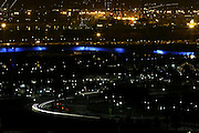 City lights twinkle in the background in this photograph of Shoreline Drive in Long Beach, California on August 12, 2003. ©Paul Anthony Spinelli