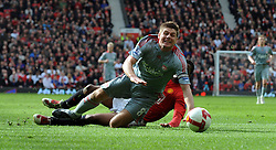 Steven Gerrard of Liverpool is fouled by Patrice Evra resulting in a penalty for Liverpool during the Barclays Premier League match between Manchester United and Liverpool at Old Trafford on March 14, 2009 in Manchester, England.