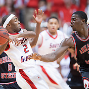 MOBILE, AL - DECEMBER 29:  Brandon Peterson #15 of the Arkansas State Red Wolves attempts to steal the ball from Dre Conner #2 of the South Alabama Jaguars at USA Mitchell Center on December 29, 2012 in Mobile, Alabama. At halftime Arkansas State leads South Alabama 28-23. (Photo by Michael Chang/Getty Images) *** Local Caption *** Brandon Peterson;Dre Conner