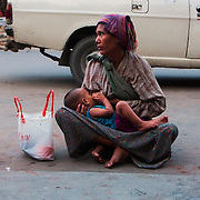 Woman breastfeeding in the streets of Mandalay