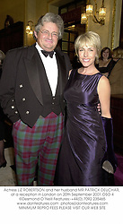 Actress LIZ ROBERTSON and her husband MR PATRICK DEUCHAR, at a reception in London on 20th September 2001.OSO 4