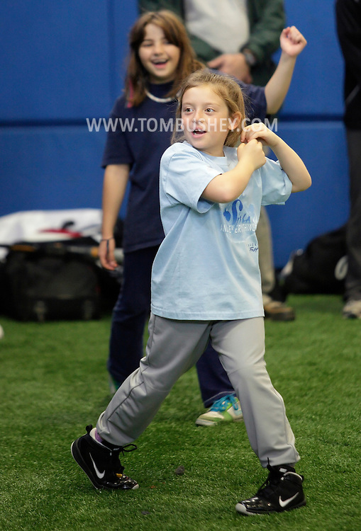Chester, New York  - Girls practice their swings at the first anniversary open house celebration at The Rock Sports Park on Nov. 12, 2011.