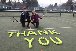 Tennis coach Josh Thomson and Nicola Wishart with tennis balls laid out at Dunblane Tennis Club in Andy Murray's home town, he has said he is aiming to end his career after Wimbledon but the Australian Open may be his last tournament.