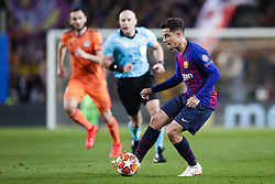 March 13, 2019 - Barcelona, Catalonia, Spain - March 13, 2019 - Barcelona, Spain - Uefa Champions League 1/8 of final second leg, FC Barcelona v Olympique de Lyon: Philippe Coutinho of FC Barcelona passes the ball through midfield. (Credit Image: © Marc Dominguez/ZUMA Wire)
