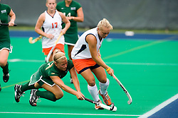 August 29, 2008 - CHARLOTTESVILLE, VA - William and Mary Tribe midfielder/forward Michelle Krewinghaus (7) dives for a ball against Virginia Cavaliers midfielder Shelly Edmonds (4).   The Virginia Cavaliers field hockey team defeated the William and Mary Tribe 5-0 on the University Hall Turf Field on the Grounds of the University of Virginia in Charlottesville, VA.