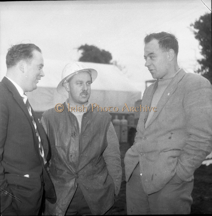 Lead Mines at Loughrea..1962..08.01.1962..01.08.1962..8th January 1962..Prospecting started in Loughrea in what is thought to be lead deposits beneath the lands of several small farms in the area...Image shows Mr Harry Collins, a mine official,. Mr P J Foley, prospector and Mr Eamon O'Reilly, farmer, at the site of the drilling operations.