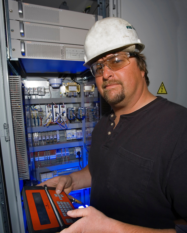 This engineer is accessing the wind towers controls through an interface at the bottom of the tower. Nine Canyon Wind Project, Richland, Washington.