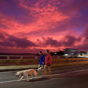 Gregg Troy, 67, left, along with his wife Kathleen, 57, walk their dog Cooper along an empty C Street as clouds break Wednesday, Oct. 10, 2018 in Cedar Key. A combined high tide and storm surge from Hurricane Michael pushed water into the low lying streets of small town Wednesday. Hurricane Michael first made landfall near Mexico Beach in the panhandle area of Florida as a catastrophic Category 5 hurricane.